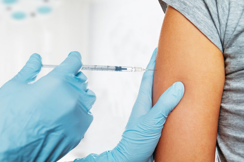 Medical vaccine in shoulder