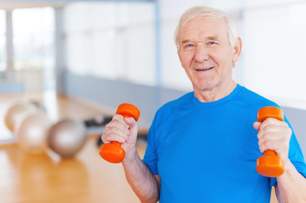 senior man exercising with dumbbells