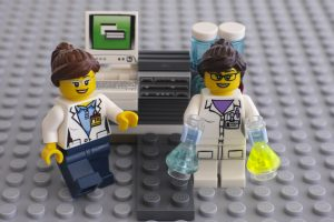Two LEGO scientists near laboratory computer