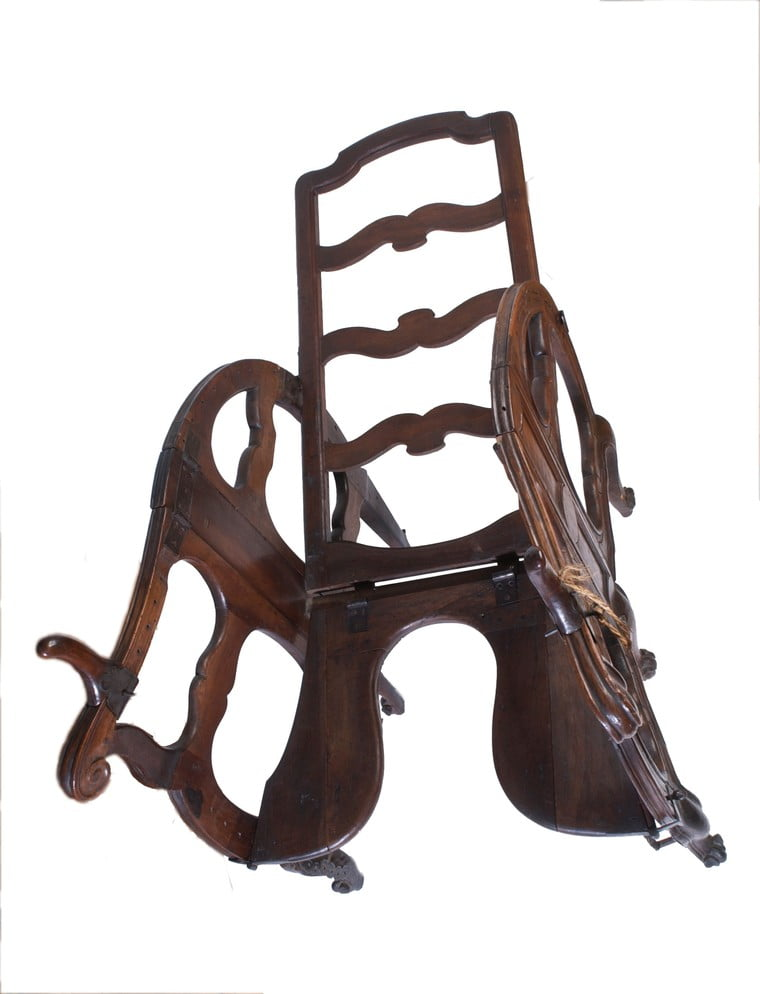 A foldable and adjustable birthing chair, made of walnut wood. European, late 17th or early 18th century.