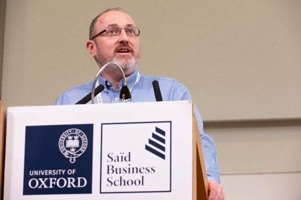 Declan Devane presenting at the symposium