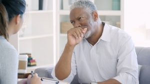 Upset senior man talks about issues with therapist