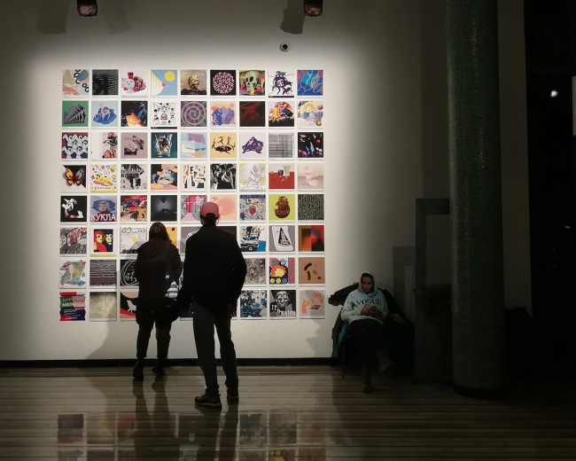 people looking at photos in a gallery