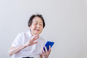 Grandmother having video chat on smart phone