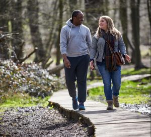 couple walking to lower blood pressure